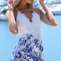 CLEMENCE PLAYSUIT - blue and white playsuit with lace covered bust area