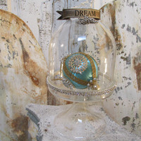 Ornate glass bell jar with stand French chic cloche display embellished with metal banner, rhinestone crown and trim anita spero