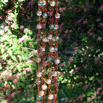 Iridescent Teal Suncatcher with Copper Wrapped Marble Prisms and Petal Pink Glass Butterflies