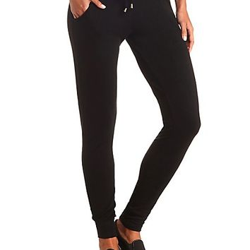 Gold-Tipped Drawstring Skinny Sweatpants by Charlotte Russe - Black