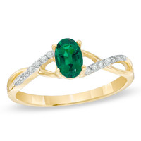 Oval Lab-Created Emerald and Diamond Accent Twist Ring in 10K Gold
