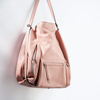 Leather bucket bag with front pocket