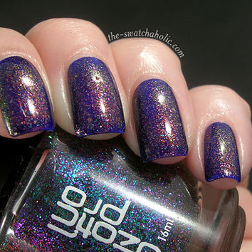 Sparkletastic layering of the day with Clarins 230 over CND Gold Sparkle over Ozotic Pro Elytra 528 over Revlon Royal | The Swatchaholic . a blog about nail polish and makeup