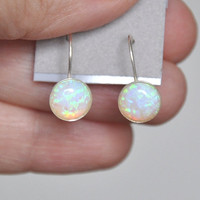 Opal dangling earrings in sterling silver with lever backs