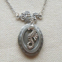 Antiqued silver locket necklace with seahorse and flower
