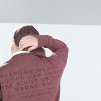 Marled sweatshirt with text at the back