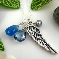 Silver feather blue charm necklace