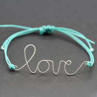 Wire Love Bracelet : Breeze. Silver Handwritten Cursive Wire 'LOVE' Bracelet with Blue Cotton Cord, Adjustable Closure, Affirmation Bracelet