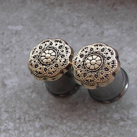 "Gold Flower Shield Plugs - Available in sizes 0g, 00g, 7/16"", & 1/2"""