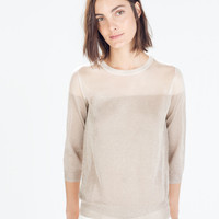 Sweater with a transparent yoke