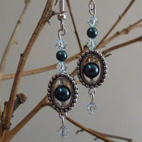 Oval bead frames with Swarovski  pearls and crystals.