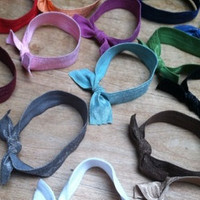 Elastic hair ties, headbands and hairbands