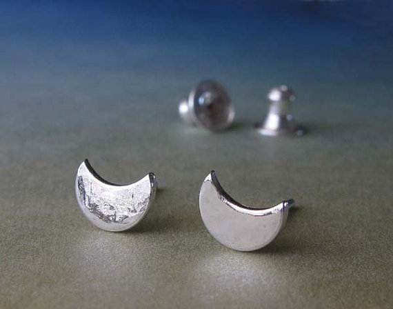 Artisan handmade minimalist  tiny crescent moon post earrings.  Textured shiny reflective studs.  Simple sterling silver jewelry for women.