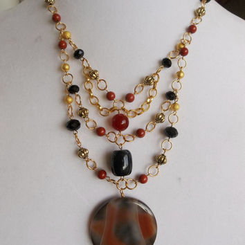 Gold Bib Necklace with Burnt Orange and Black Stones and Crystals and a Carnelian Gemstone Focal Piece // 19 inches // Can Customize Size