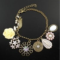 Vintage charm bracelet with pink and yellow flowers
