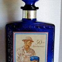 Vintage cobalt bourbon bottle by J.W. Dant American Legion 50th anniversary 1969
