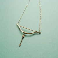 Golden bow and arrow necklace by datter on Etsy