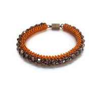 Orange Cubic Right Angle Weave Bracelet Embellished with Chocolate Brown Chinese Crystals