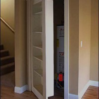 Style File / Bookshelf closet door -- genius!  truly!