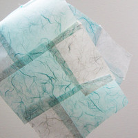 Sewn paper scraps made from mulberry paper. Blue, light blue, snow. For unique gift wrap, collages, paper projects, bookbinging