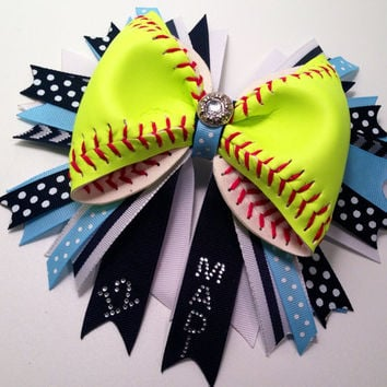 """Custom Softball Bow with double layer 7"""" Spike ribbons with player name and number added to ribbon. Up to six letters."""