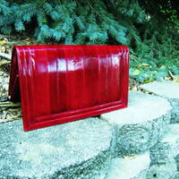 vintage deep red, accordian style eel skin clutch. fall fashion