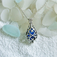 Sea glass locket necklace. Blue teardrop locket. Sea glass jewelry.