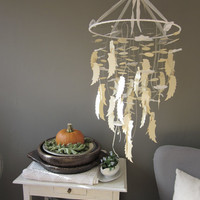 A dream catcher inspired angel wing mobile in honey and off white --- A gorgeous mystical mobile perfect for a nursery or as weddingdecor