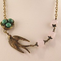 Swallow and the eggs necklace by peeno123 on Etsy