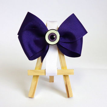 Eyeball Hair Bow!! Cute every day dark purple hair bow. This special eyeball bow is perfect for every kind or girl!