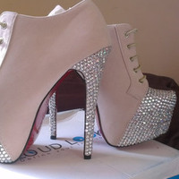 A Pair of Glam blinged up shoe boots with extra high stiletto heels
