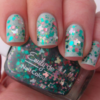"Nail polish - ""Flutterby Garden"" pink and green glitter in a clear base"