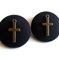 Gold cross on large black button earrings