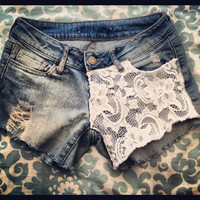 Low rise lace shorts with distressing