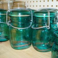 Two one pint Ball jars blue/green with glass lid and by lcbabies