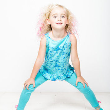 Fun jersey spandex leggings in turquoise with pink bows at cuff