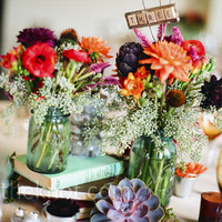 Real Weddings - A Rustic Outdoor Wedding in Bronx, NY - Book and Floral Centerpieces