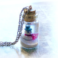 Bottle necklace, snowman and a winter wonderland scene, snow globe, bottle pendant
