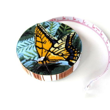 Tape measures, scarves,cowls,gloves,clocks and more mostly embellished with buttons!