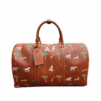 The Travel Bag inspired by Wes Anderson's The Darjeeling Limited movie. Made of genuine leather, it can be personalized with your initials.