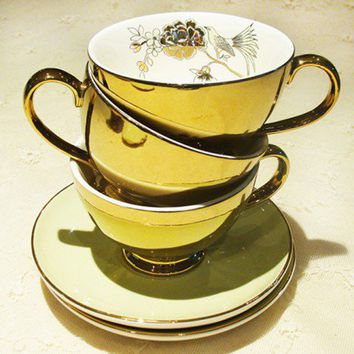 Gold Teacup and Saucer- Miss Etoile