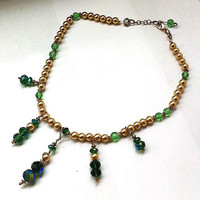 Regal emerald crystal and gold pearl necklace