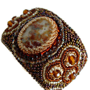 Bead embroidery cuff bracelet with a Crazy Lace Agate cabochon. Seed beads jewelry