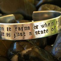 Beatles song lyrics bracelet.  When it rains or when it shines