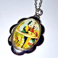 Alice's Adventures in Wonderland: blue Caterpillar smoking hookah on a mushroom pendant necklace