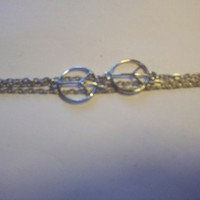 Silver chain bracelet with peace signs