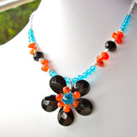 Wire wrapped black flower necklace with blue crystal orange carnelian briolette bead flower jewelry