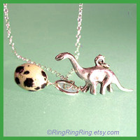 egg with female Dinosaur necklace on adjustable by RingRingRing