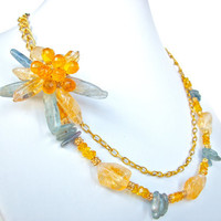 Gemstone flower necklace wire wrapped with blue kyanite and golden yellow citrine gemstones on gold chain, statement necklace