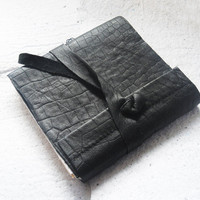 Handbound leather pocket journal with handmade end papers. visible black bound book 4.5x5 inches.